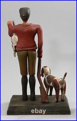 Vintage Folk Art wood carving sculpture of hunter, dog, rabbit