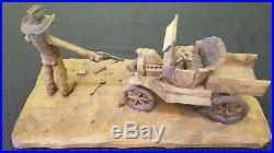 Vintage Gene Zesch Wood Carved Sculpture Cowboy Shooting Car 1971